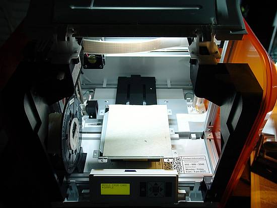 Printer with light on and door open
