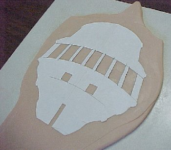 template placed on the sheet of Super Sculpey