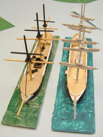 Scratchbuilt masts (left) and masts from kit