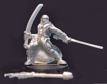 The figure on its slottabase, with separate weapon